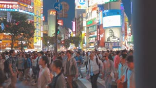 Japanese people crossing the street outside the famously crowded Shibuya station