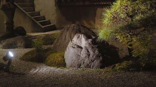 Japanese rock garden at night in Kyoto, sliding shot