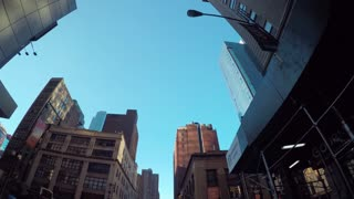 Looking up at the buildings surrounding Times Square, Manhattan