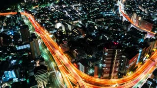 Night becomes day over a massive highway intersection in Tokyo, Japan