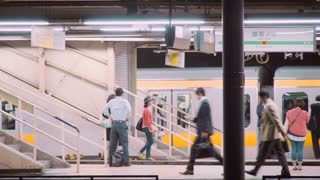 People boarding and exiting trains at the subway station in Tokyo