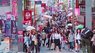 People shop along on Takeshita Street in Harajuku, Tokyo, Japan