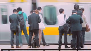 People waiting to board a train at the subway station in Tokyo