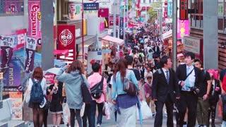 People walk along Takeshita Street in Harajuku, Tokyo