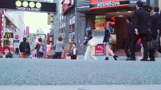 People walk and shop along the Takeshita Street in Harajuku, Tokyo, Japan