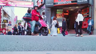 People walk and shop along the Takeshita Street in Harajuku, Tokyo, Japan