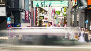 People walk and shop along the Takeshita Street in Harajuku, Tokyo,