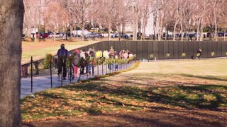 People walking through the Vietnam Veterans Memorial