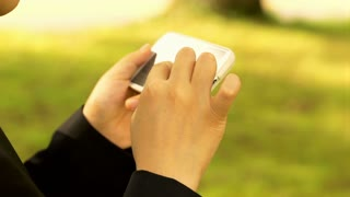 Person using cellphone outside