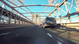 Point of view ride over the Brooklyn Bridge traveling into lower Manhattan, NY