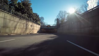 Point of view time-lapse driving shot entering the 9th st. expressway tunnel in
