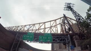 POV drive under the Queensboro Bridge, NY