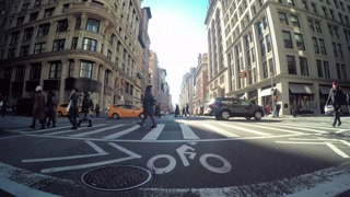 POV driving shot of Manhattan, NY with pedestrians crossing the street