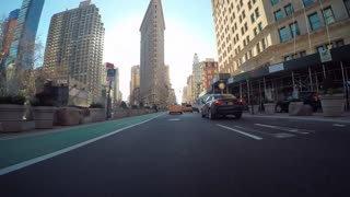 POV driving shot through Manhattan with a view of the Flatiron building