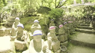 POV shot through the garden of 500 statues of the garden of Daisho-in Temple