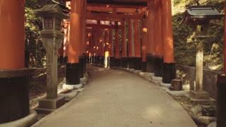 POV slomo walk through the famous orange gates at Fushimi Inari shrine in Kyoto