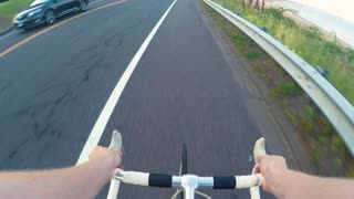 POV time-lapse of a person riding a bicycle near the beach