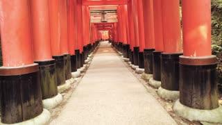 Slow-motion POV walk through the famous orange gates at Fushimi Inari Shrine