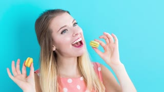 Time-lapse of a young woman doing a variety of poses with snacks