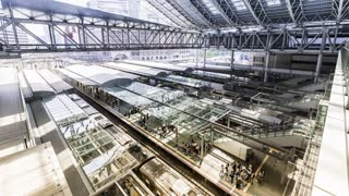 Time-lapse of commuters and trains inside Osaka Station