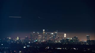 Time-lapse of downtown LA at night with planes circling
