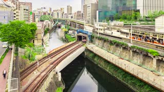 Time-lapse of multiple train lines in Tokyo at dusk