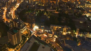 Time-lapse of of curving streets running through Tokyo from above at night