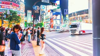 Time lapse of people and traffic crossing Shibuya intersection