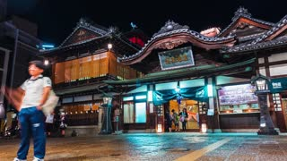 Time-lapse of people surrounding the ancient Japanese bathhouse Dogo Onsen
