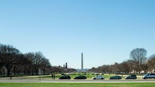 Time-lapse of the Washington monument with traffic passing in front