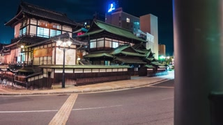 Time lapse of traffic surrounding the ancient Japanese bathhouse Dogo Onsen