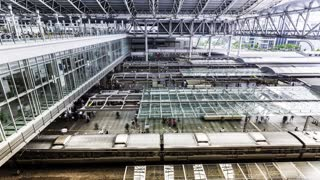 Time-lapse of trains and commuters inside Osaka Station