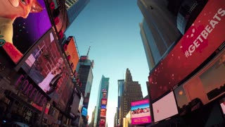 Time-lapse shot looking up at the buildings surrounding Times Square, Manhattan