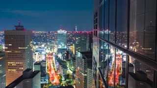 Time-lapse Tokyo from atop a skyscraper at night in Shinjuku, Tokyo, Japan