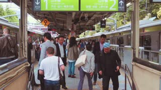 TOKYO - CIRCA JUNE 2015: People exit and enter the Yamanote line at Harajuku Station, Tokyo, Japan.