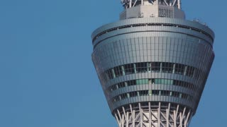 Tokyo Sky Tree close up with an airplane emerging from behind