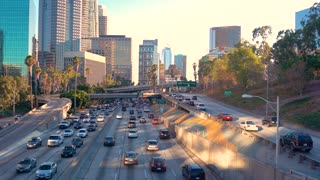 Traffic down a busy freeway through Downtown LA