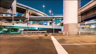 Traffic time lapse under the massive highway system