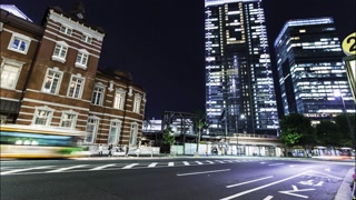 Traffic, trains and elevators time-lapse outside of Tokyo Station