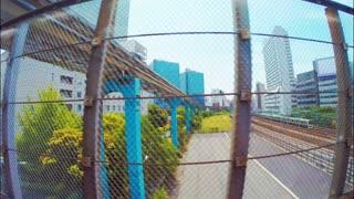 Train traveling through Tokyo