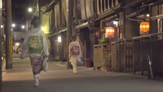 Two Geisha walking down the street in the Gion district of Kyoto