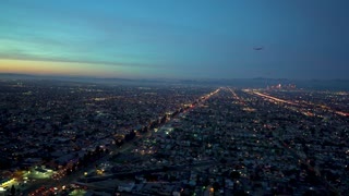 Aerial view of Los Angeles in 4K from a helicopter at sunset