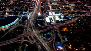 Aerial view of the 110 and 10 highway intersection in Downtown Los Angeles in 4K from a helicopter