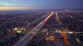 Aerial view of the 110 expressway in Los Angeles in 4K from a helicopter at sunset