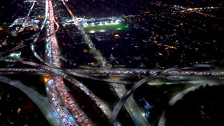 Aerial view of the 405 and 110 highway intersection in Downtown Los Angeles in 4K from a helicopter