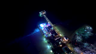 Aerial view of the beach in Santa Monica, CA in 4K from a helicopter at night