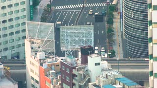 Aerial view of Tokyo traffic high above the district of Toranomon