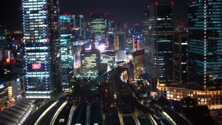 Aerial view of trains arriving and departing Tokyo Station in Marunouchi, Tokyo, Japan