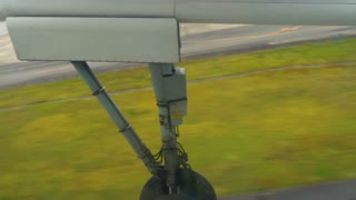 Airplane liftoff from the airport with wheels retracting