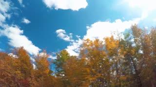 Autumn POV driving shot of the Blue Ridge Parkway through North Carolina at sunset